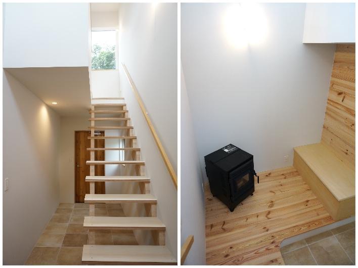 光が降り注ぐ吹き抜けの階段。玄関の土間スペースから一段小上がりで、ベンチとペレットストーブの空間。