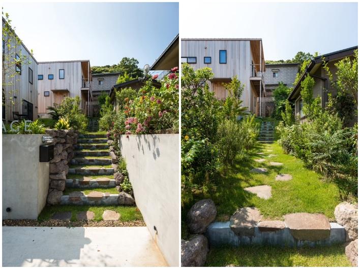 玄関までのアプローチ。隣家とは塀をつくらない、互いの庭を借景にするヴィレッジの思想により、緑たっぷりな気持ちのいい外構に仕上がっています。